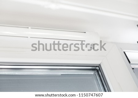Double glazed window with ventilation unit. Closeup. Nobody #1150747607