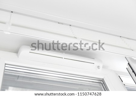 Double glazed window with ventilation unit. Closeup. Nobody #1150747628