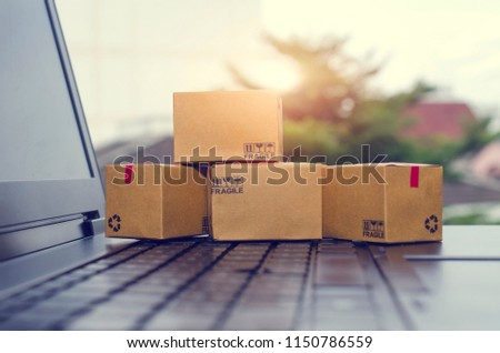 Paper boxes on a laptop keyboard.Easy shopping with finger tips for consumers.Online shopping and delivery service concept. #1150786559