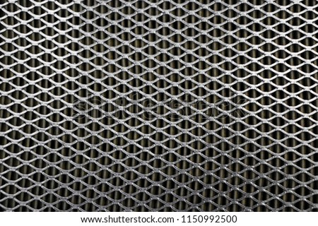 Steel mesh. Grid of car air filter. Metal grill texture of vehicle air filter #1150992500