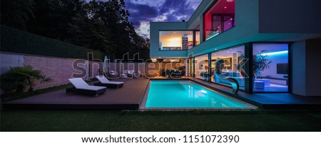 Modern villa with colored led lights at night. Nobody inside Royalty-Free Stock Photo #1151072390