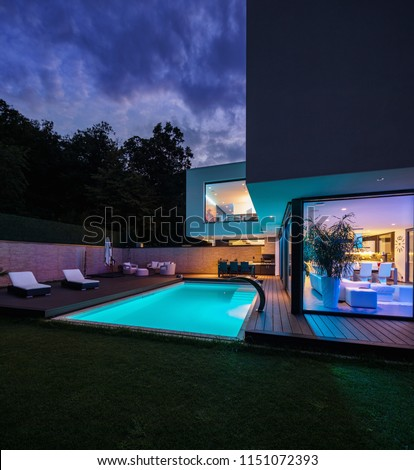 Modern villa with colored led lights at night. Nobody inside #1151072393