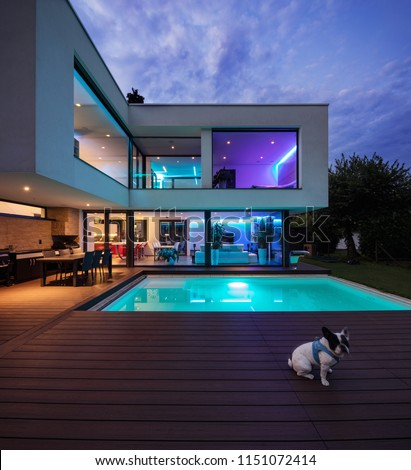 Modern villa with colored led lights at night. Nobody inside #1151072414