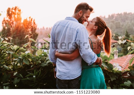 Young couple in love enjoying their honeymoon Royalty-Free Stock Photo #1151223080