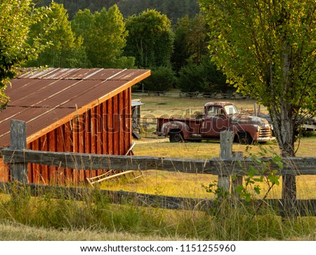 Pacific NW Puget Sound: Orcas Island farm scene with red barn and old Chevy Truck #1151255960