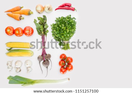 flat lay with fresh autumn vegetables arranged isolated on white #1151257100