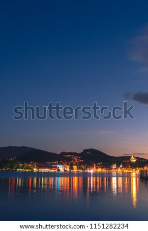 Night summer view on Alps mountains lake and Pilatus mountain, city glows, travel and vacation in Europe, embankment, Luzern, Switzerland, vertical photo #1151282234