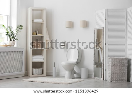 Toilet bowl in modern bathroom interior #1151396429