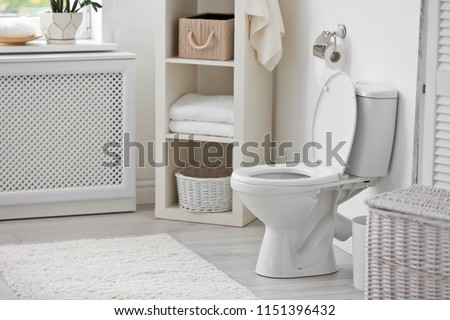 Toilet bowl in modern bathroom interior #1151396432