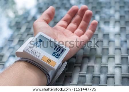 Blood pressure monitor indicates low blood pressure #1151447795