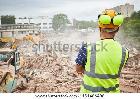 Demolition construction work. Worker at building site Royalty-Free Stock Photo #1151486408