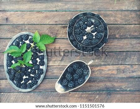 Blackberry served in vintage silver tableware. #1151501576
