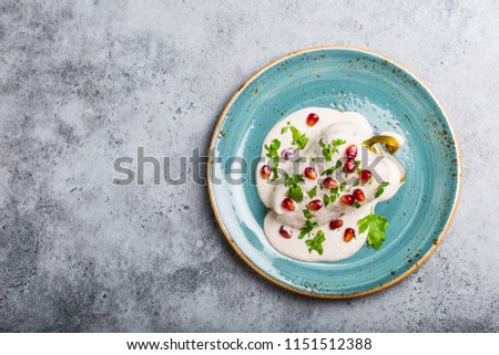 Top view of chiles en nogada, traditional festive dish on Mexican Independence Day. Peppers chili with walnut sauce, appetizer usual for Mexico, for celebration and grand food fiesta. Space for text #1151512388