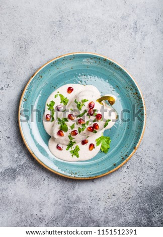Top view of chiles en nogada, traditional festive dish on Mexican Independence Day. Green peppers chili with walnut sauce, appetizer usual for Mexico, for celebration and grand food fiesta  #1151512391