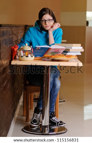 Beautiful college student in pizzeria #115156831