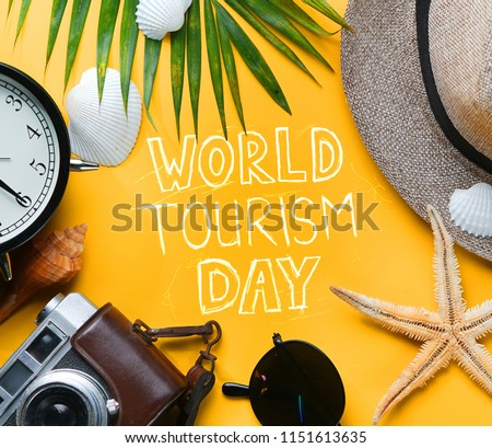 World Tourism Day Typography. Flat Lay Traveling Holiday Vacation Yellow Background #1151613635
