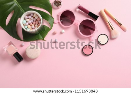 Flat lay composition with products for decorative makeup on pastel pink background #1151693843