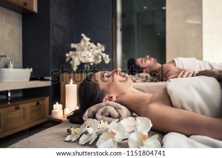 Young man and woman lying down on massage beds at Asian luxury spa and wellness center #1151804741
