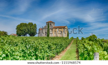 old chapel in the vineyards of cognac Royalty-Free Stock Photo #1151968574