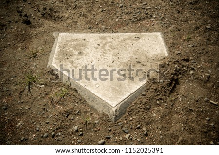 dirt covered baseball home plate #1152025391