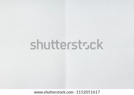 Folded sheet of paper. White background. Empty space. #1152051617