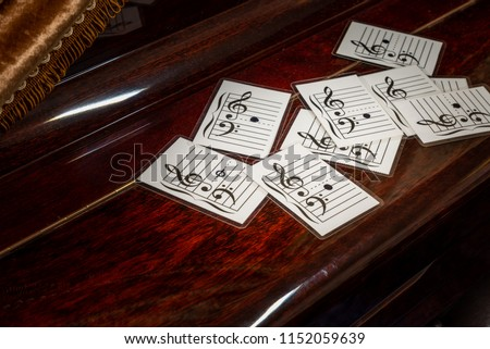 Music note on flash cards on old wooden piano. Concept for learning music note with flash cards.