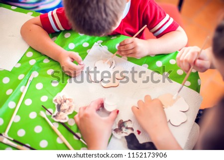 Children hands making artworks with wood and paint crafts. workplace and handcraft Decoupage #1152173906