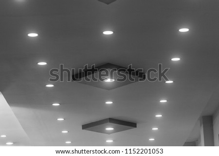 interiors of illuminated rooftop lights forming a pattern or lines. low light black and white photography with selective focus on the subject #1152201053