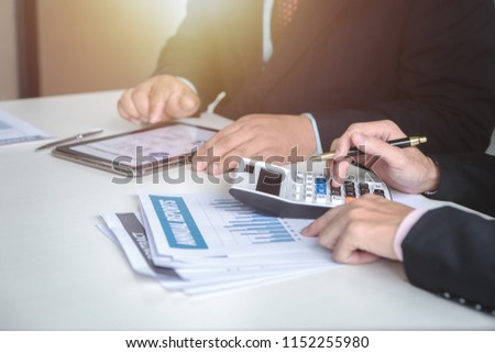 Team of business man hands pointing on chart. Professional investor meeting with new startup,Teamwork concept,discussion document in office.Collaborative filtering.Analyze plans.selective focus. #1152255980
