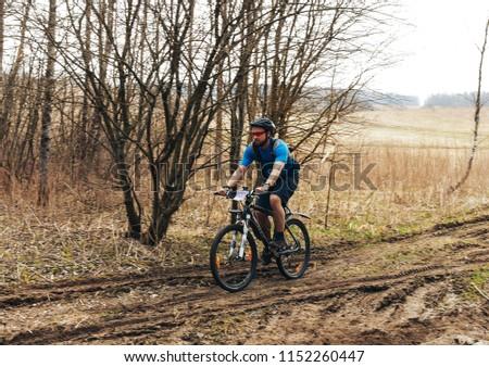 April 15, 2018, Krevo, Belarus.Beetle Trail Krevo A man is running along the trail in the field #1152260447