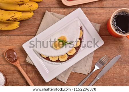 Tapioca filled with hazelnut cream and banana slices #1152296378