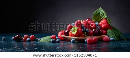 Berries closeup colorful assorted mix of strawberry, blueberry, raspberry and sweet cherry in studio on dark background. #1152304871