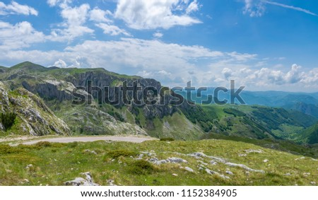 A picturesque road among the mountains in the National Park Durmitor. #1152384905