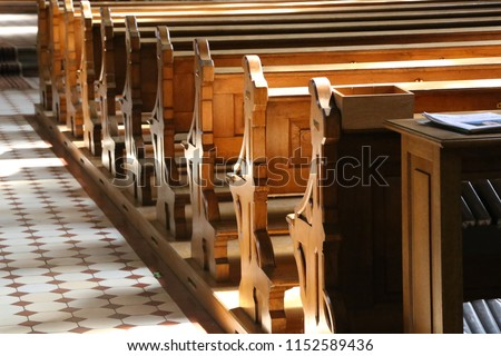 Church wooden bench Royalty-Free Stock Photo #1152589436