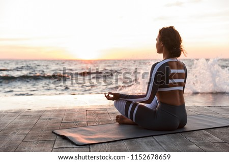 Image of strong young fitness woman outdoors in the beach make yoga meditate exercises. #1152678659