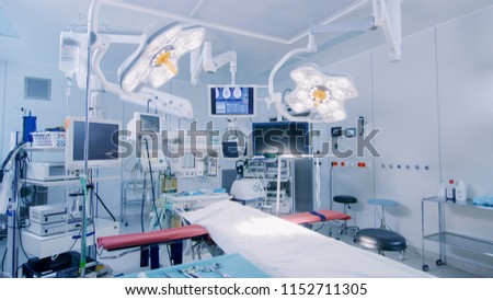 Establishing Shot of Technologically Advanced Operating Room with No People, Ready for Surgery. Real Modern Operating TheaterWith Working equipment,  Lights and Computers Ready for Surgeons. #1152711305