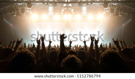 Concert crowd clapping and holding smart phones #1152786794