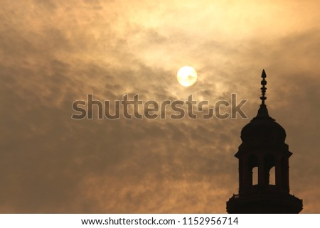 Islamic architecture tower silhouette against evening sky #1152956714