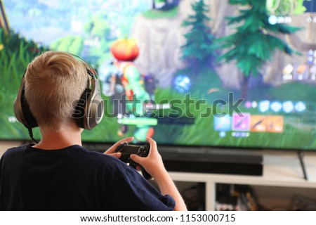 Boy playing Fortnite #1153000715