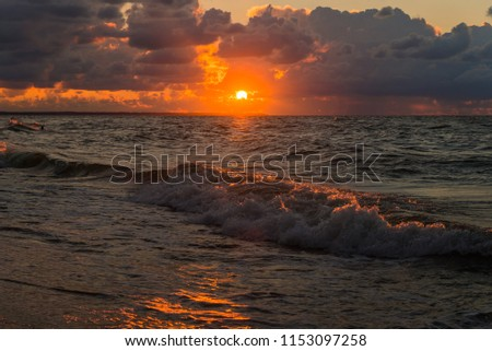 Outstanding sunset seascape view during stormy weather on Baltic sea. #1153097258