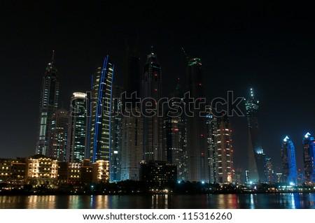 DUBAI, UAE - NOVEMBER 26: Skyscrapers in Dubai Marina at night, United Arab Emirates, Nov 26, 2011 Dubai is the most expensive city in the Middle East. #115316260