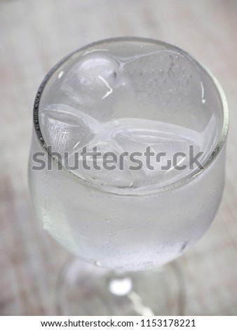 Ice water in a glass cup  #1153178221