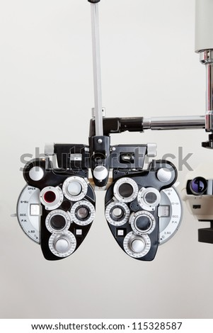 Phoropter optical device for measuring the vision of human eye Royalty-Free Stock Photo #115328587