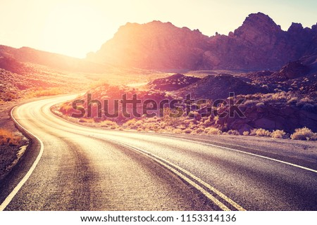 Vintage toned scenic desert road at sunset, travel concept, USA.