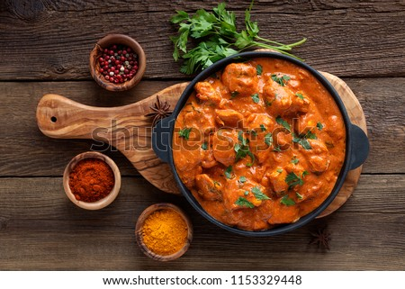 Tasty butter chicken curry dish from Indian cuisine. Royalty-Free Stock Photo #1153329448