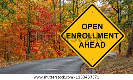 Open Enrollment Caution Sign With Autumn Road Background #1153433371