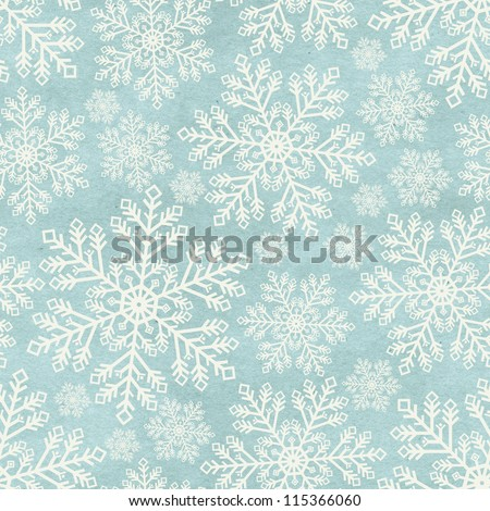 Seamless winter pattern on paper texture. Christmas background