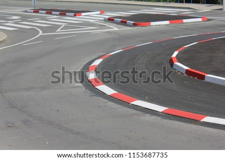 New traffic rotor in the city with red white lines #1153687735