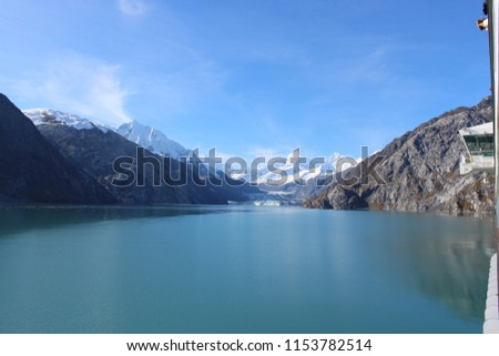 Cruising Off the Alaskan Coast. Beautiful mountains and Ice- Great for a background or banner #1153782514