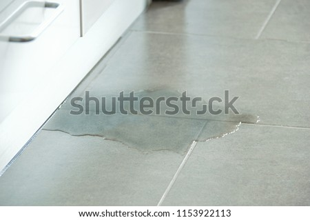 Close-up Photo Of Flooded Floor In Kitchen From Water Leak Royalty-Free Stock Photo #1153922113